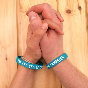 wristband holding hands